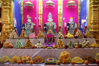 The huge annakut formed of various sweets and savoury items is offered to the Lord