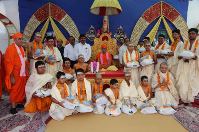 His Divine Holiness Acharya Swamishree blesses all the young Bhramins