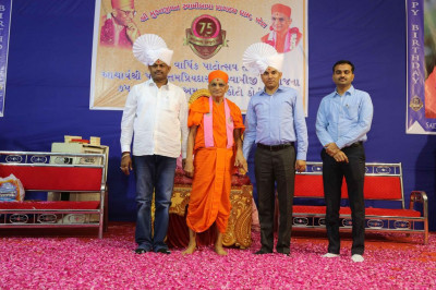 His Divine Holiness Acharya Swamishree blesses honoured guests and disciples