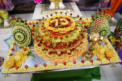 A special cake, made of intricate fruit carvings, to celebrate Acharya Swamishree's 75th manifestation day