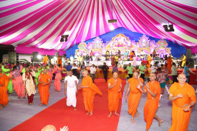 Sants dance to devotional songs to please the Lord