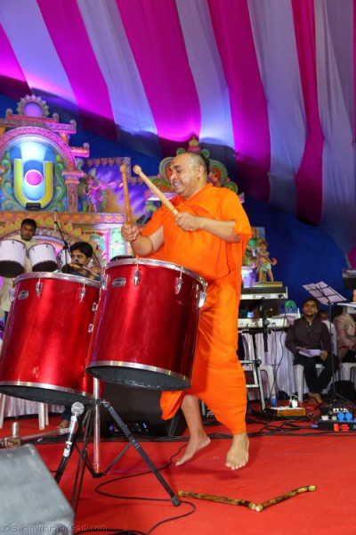 Sants perform drums during raas