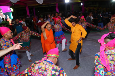 Sants, disciples and artists dance to devotioal songs during raas