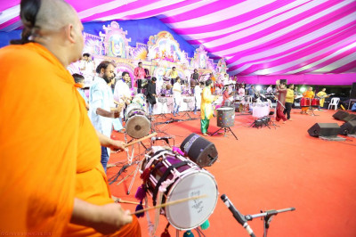 The stage is filled with talented sants, disciples and professional musicians all performing devotional songs together