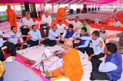 Disciples take part inthe scripture recitals poojan ceremony