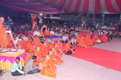His Divine Holiness Acharya Swamishree, sants and hundreds of disciples enjoy the evening devotional performances