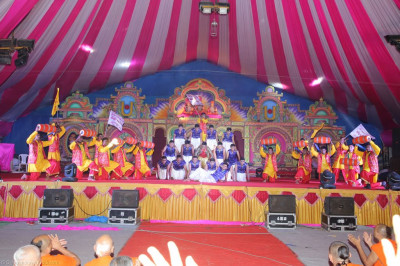 Disciples in colourful traditional Indian dress perform the finale devotional dance