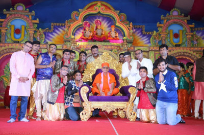 His Divine Holiness Acharya Swamishree blesses disciples who took part in the evening devotional drama performances