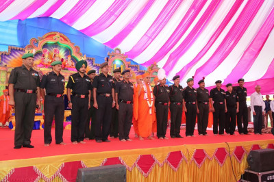 His Divine Holiness Acharya Sawmishree blesses all honoured guests on stage as the national anthem is sung