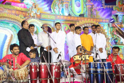 The chorus team perform enhancing the devotional songs