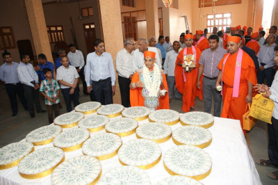 His Divine Holiness Acharya Swamishree consecrates all gifts to be offered to the Lord