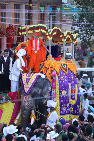 His Divine Holiness Acharya Swamishree dismounts from the elephant