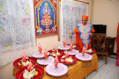 His Divine Holiness Acharya Swamishree consecrates all gifts offered to the Lord
