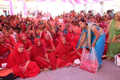 Gifts and momentos are presented to the Sankhya Yogi ladies during the celebrations