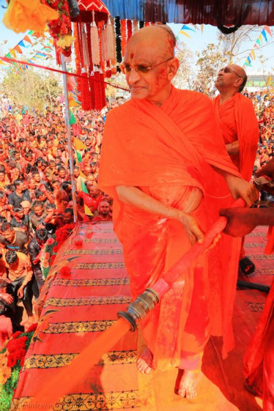 His Divine Holiness Acharya Swamishree showers all with different colours