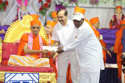 His Divine Holiness Acharya Swamishree presents various donations to local charitable organisations