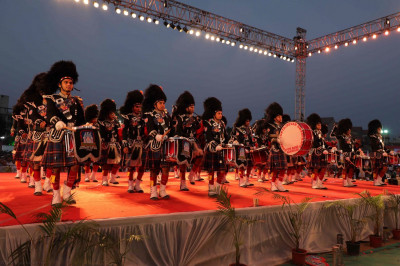 Shree Muktajeevan Swamibapa Pipe Band performs a pipes-dhol fusion in celebration of Acharya Swamishree's Sadbhav Amrut Parva