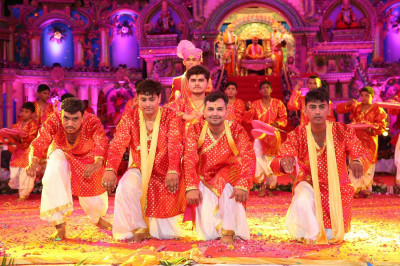 Disciples perform a devotional dance to please Lord Swamiinarayanbapa Swamibapa and Acharya Swamishree