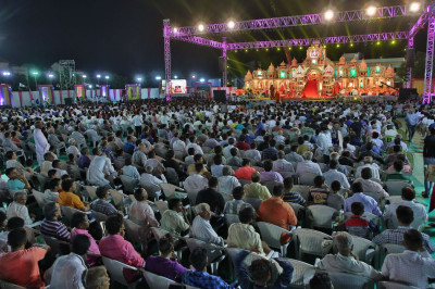 Thousands of disciples from all around the world watch the evening's celebrations