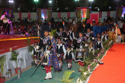 Shree Muktajeevan Swamibapa Pipe Band Maninagar and young cadets escort event sponsors carrying new scriptures and CD album to be inaugurated