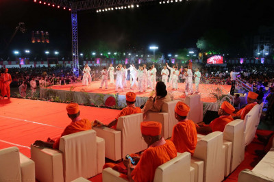 Disciples perform a devotional dance to please Lord Swaminarayanbapa Swamibapa and Acharya Swamishree