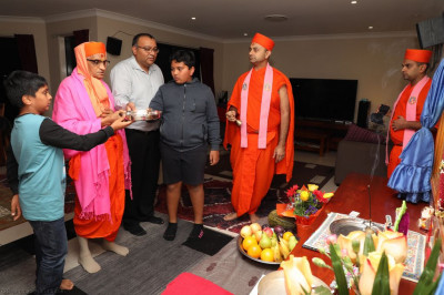 His Divine Holiness Acharya Swamishree and disciples offer aarti