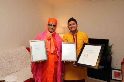 His Divine Holiness Acharya Swamishree blesses a disciple who has very recently attained qualifications