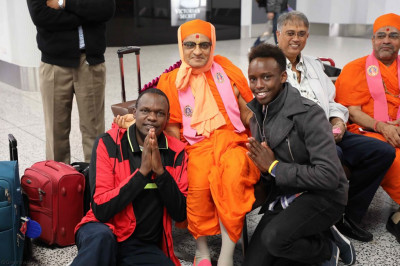 His Divine Holiness Acharya Swamishree blesses travellers visiting the airport