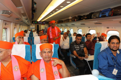 His Divine Holiness Acharya Swamishree blesses all sants and disciples on board the train