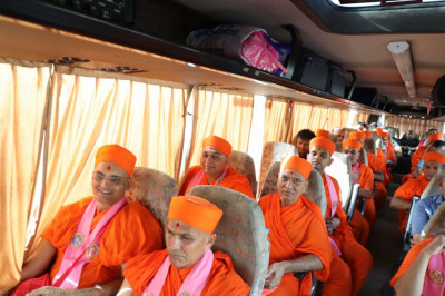 Sants and disciples travel to Mumbai airport at the start of the Australian yatra