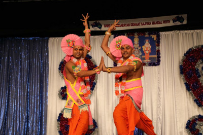 Sants perform a devotional dance to please Lord Shree Swaminarayan