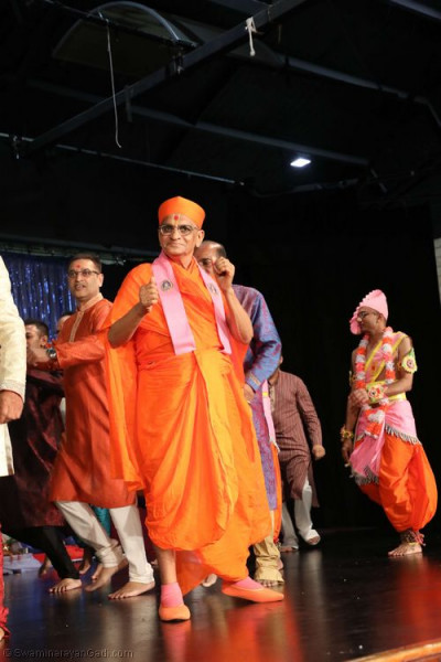 His Divine Holiness Acharya Swamishree and disciples dance to a devotional song