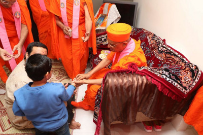 His Divine Holiness Acharya Swamishree performs the initiation ceremony welcoming new disciples