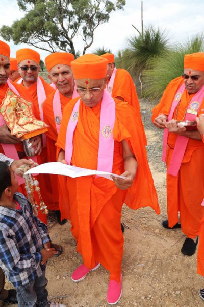 His Divine Holiness Acharya Swamishree blesses the plans for the construction of the building