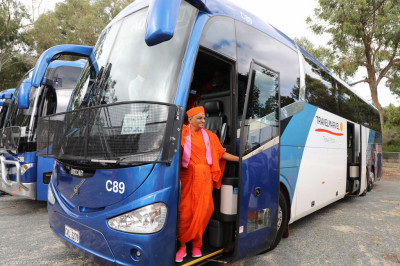 His Divine Holiness Acharya Swamishree on one of the three coaches