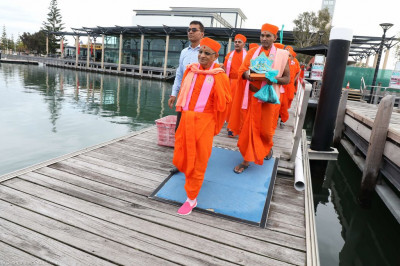 His Divine Holiness Acharya Swamishree boards the boat