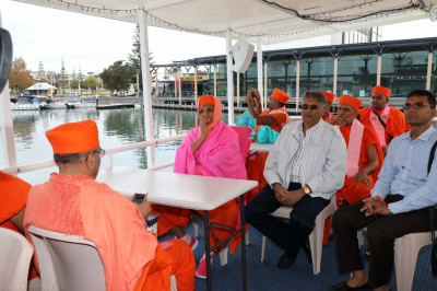 His Divine Holiness Acharya Swamishree, sants and disciples aboard the boat