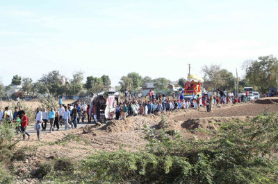 The procession proceeds from the outskirts of the village towards Shree Swaminarayan Mandir Salal