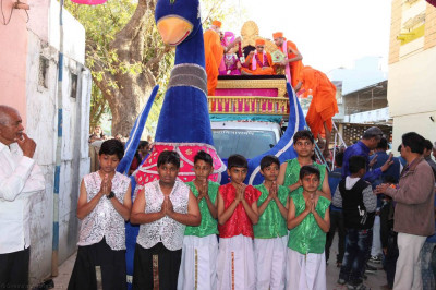 His Divine Holiness Acharya Swamishree blesses young disciples who performed the dance