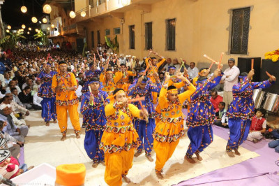 Disciples perform a dandia dance