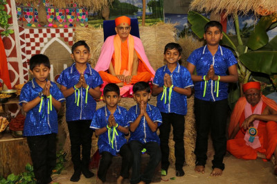 His Divine Holiness Acharya Swamishree blesses young disciples who performed in the various dances