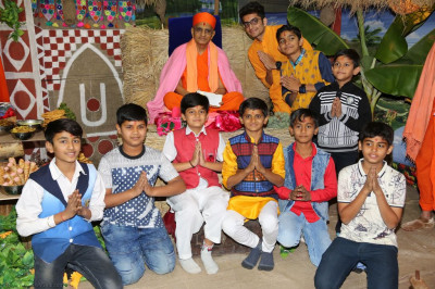 His Divine Holiness Acharya Swamishree blesses young disciples who played various instruments
