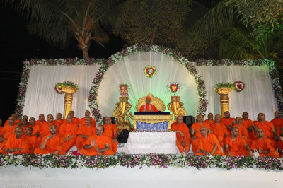 The magnificent white stage with His Divine Holiness Acharya Swamishree seated in the centre surrounded by sants