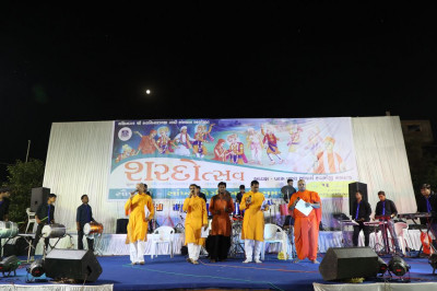 Sants, disciples and talented musicians perform devotional songs throughout the raas