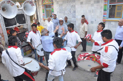 Disciples perform on various percussion instruments during the procession