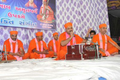 Sants, disciples and talented musicians perform various devotional songs to please Lord Shree Swaminarayanbapa Swamibapa