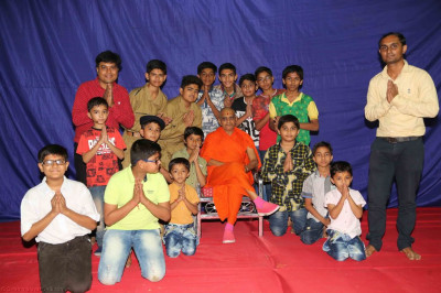 His Divine Holiness Acharya Swamishree blesses disciples who took part in the programme