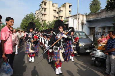 Shree Muktjeevan Swamibapa Pipe Band Maninagar performs during the procession