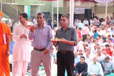 Disciples perform aarti