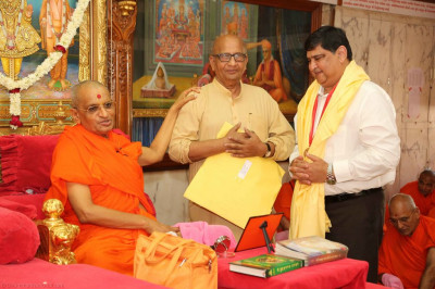 His Divine Holiness Acharya Swamishree blesses the honoured guests